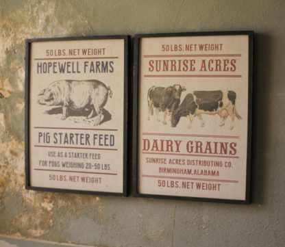 pig and cow feed sacks framed