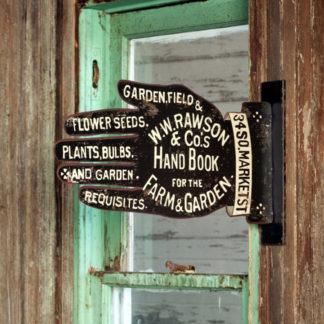 vintage metal garden supply shop sign